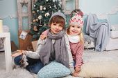 pic of little boys only  - Little girl and boy with new year gifts around the Christmas tree - JPG