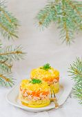 stock photo of mimosa  - traditional Russian vegetable salad with a salmon Mimosa - JPG