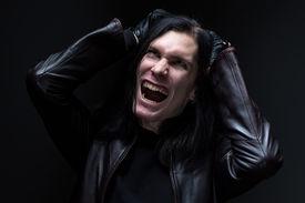 image of madman  - Image of the madman on black baclground - JPG