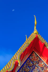 picture of apex  - Gable apex on thai temple roof and blue sky background - JPG