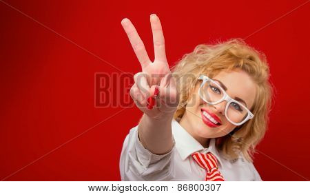 Smile Young Woman Showing With Fingers Peace - Sign Ok, Isolated On Red
