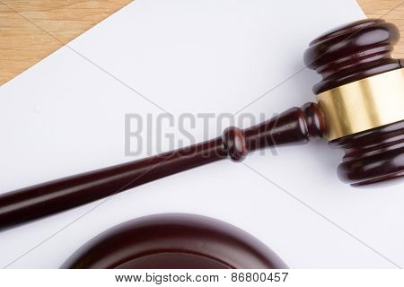 judge hammer on white paper and table