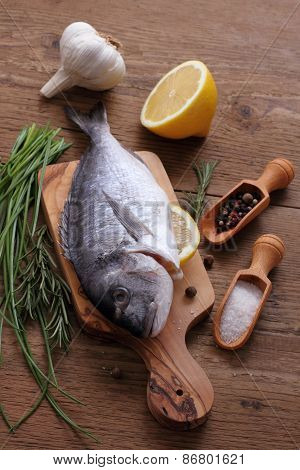 Sea Bream With Ingredients On Cutting Board