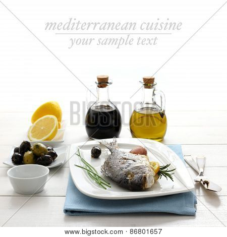 Garnished Grilled Sea Bream With Lemon, Olives And Oil