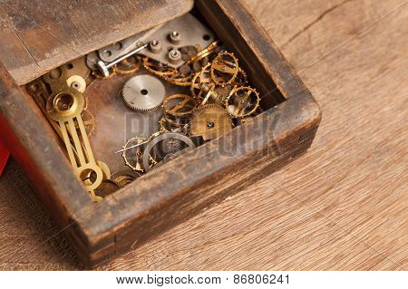 Gears And Parts Of The Clock In The Old Wooden Box