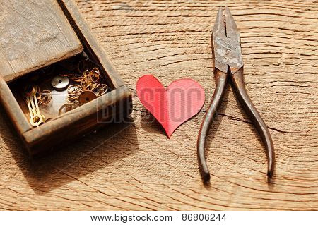 Rusty Pliers And A Wooden Box With Gears