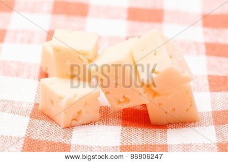 Cubes Of Cheese On The Kitchen Table Cloth