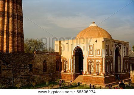 People Looking At The Qutub Minar Delhi