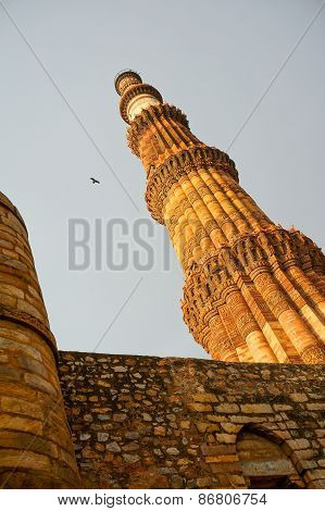 Qutub Minar Against A Stone Wall