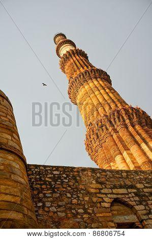 Qutub Minar Against A Stone Wall