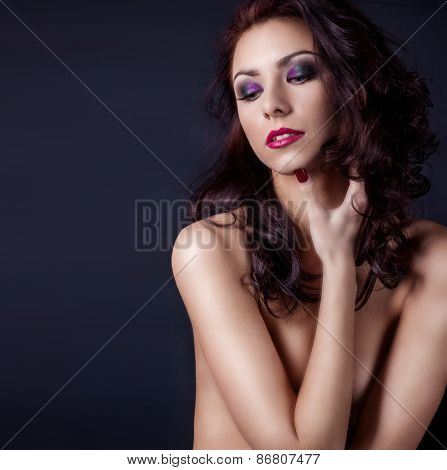 beautiful sexy Nude woman covered with hands body with beautiful bright makeup, wavy black hair