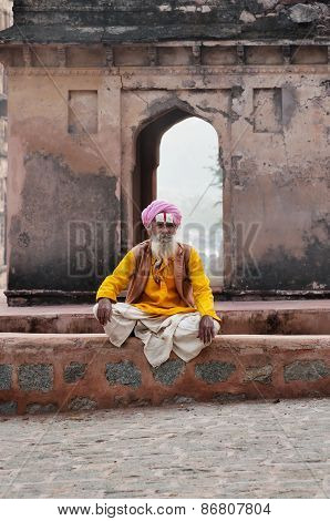 Sadhu Sitting Near Temple On The Street In Orchha