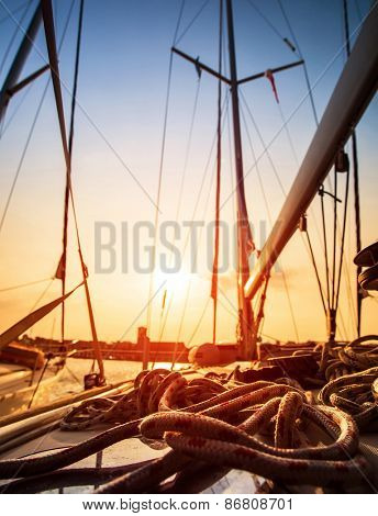 Sailboat in sunset light, sail yacht detail, yachting sport, adventure in the sea, summer holidays, luxury water transport