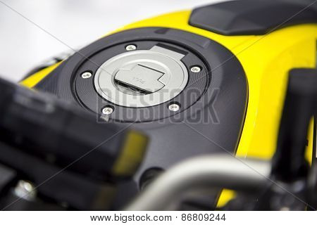 Close Up Shot Of A Yellow Motorcycle Fuel Tank Cover Cap