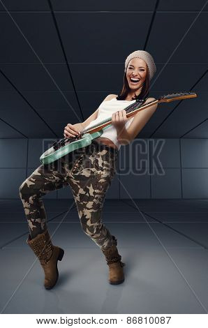 Beautiful Young Woman Playing Rock Guitar And Singing