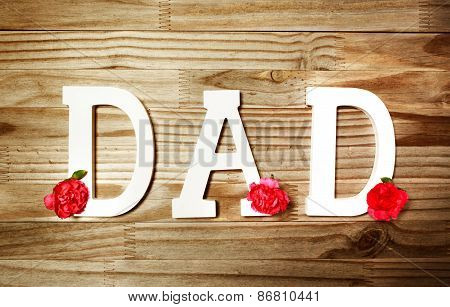 Dad Text In White Wooden Letters With Flowers