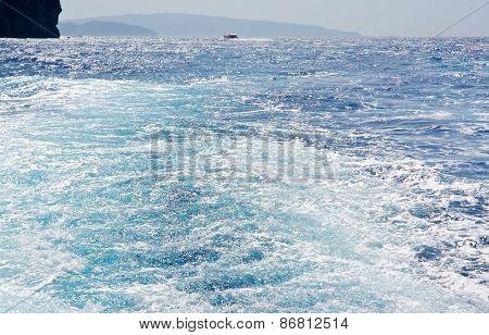 Sunny boat seafoam wake