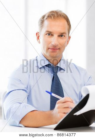 picture of handsome businessman taking employment inteview