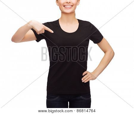 t-shirt design, happy people concept - smiling woman in blank black t-shirt pointing finger at herself