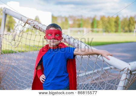 Superhero Standing Near Football Goal