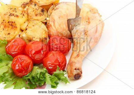 Fried Chicken Leg With Potatoes And Marinated Tomatoes