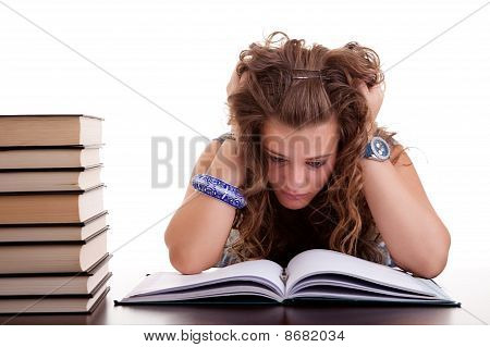 Girl Stressed Because Of  Work On Her Desk,  Pulling Hair, Isolated On White. Studio Shot