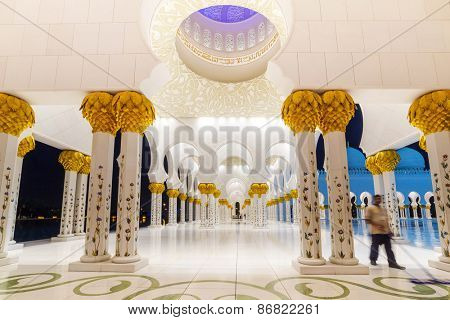 ABU DHABI, UAE - MARCH 27: Columns of Sheikh Zayed Grand Mosque in Abu Dhabi on March 27, 2014, UAE. It is the largest mosque in the United Arab Emirates and the eighth largest mosque in the world.