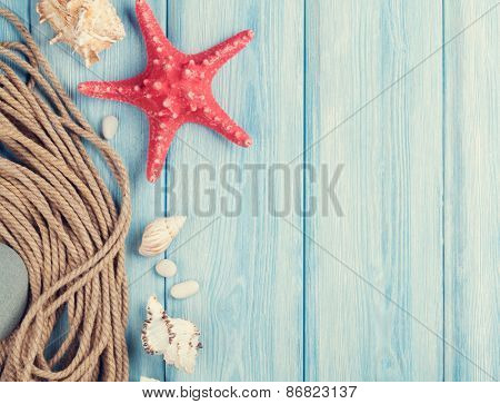 Summer time sea vacation background with star fish and marine rope. Retro toned