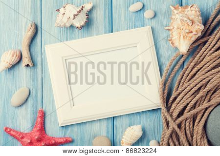 Summer time sea vacation with blank photo frame, star fish and marine rope. Retro toned