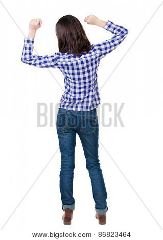 Back view of  joyful woman celebrating victory hands up. Rear view people collection. backside view of person. Isolated over white background.