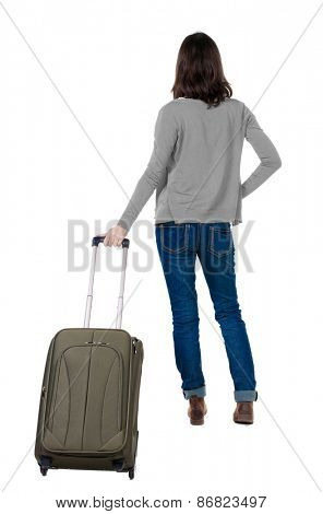 back view of walking  woman  in cardigan with suitcase. beautiful  girl in motion.  backside view of person.  Rear view people collection. Isolated over white background.