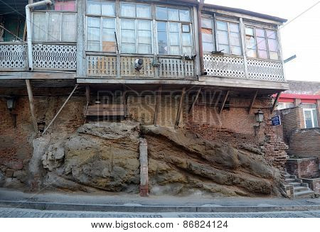 Tbilisi balconies. Old house on the rock shoes