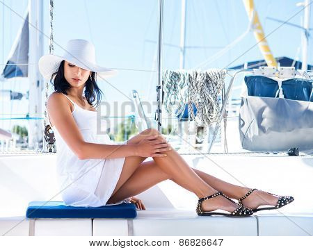 Beautiful woman relaxing on a yacht