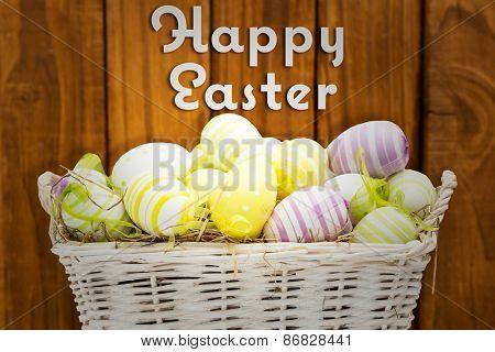 Easter eggs in basket against happy easter