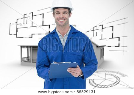 Confident supervisor writing notes against house in grey with architect plans