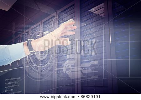 Businessman showing with his hand against digitally generated server room with towers