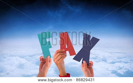 Hands holding up fax against white clouds under blue sky