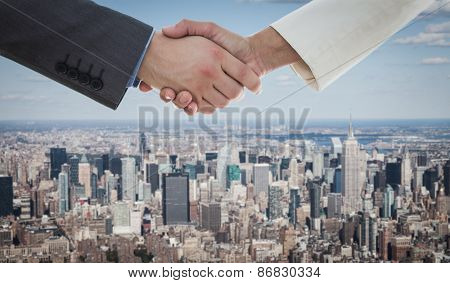 Shaking hands over eye glasses and diary after business meeting against new york