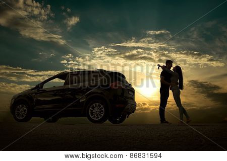 Silhouette of happiness couple stay near the new car under sky