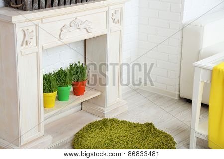 Fireplace with beautiful spring decorations in room