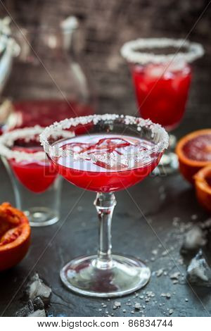 Blood Orange Margarita in glass with salted rim