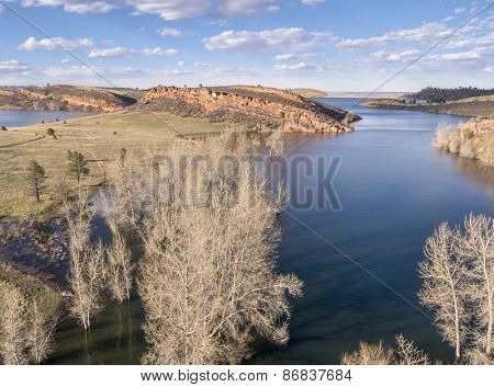 aerial view of Horsetooth Reservoir near Fort Collins Colorado, early spring with high water level and cottonwood trees in water