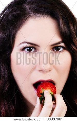 Tight Shot Of Caucasian Woman Putting Strawberry In Mouth