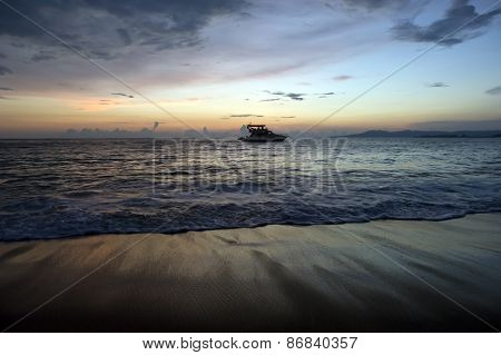 Sport Fishing Boat Is Boating With An Ocean Sunset