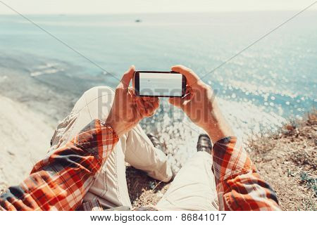 Traveler Taking Photographs Sea With Smartphone