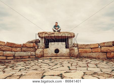 Traveler Man Sitting On Stone Dolmen