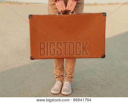 Traveler Holding A Suitcase, View Of Hands