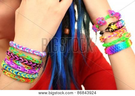 Female hands with bracelets, closeup