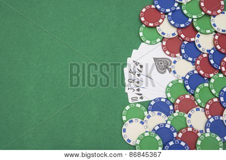 10 To Ace Spade Straight Flush Of Pokers And Lots Of Chips On Casino Table With Copy Space