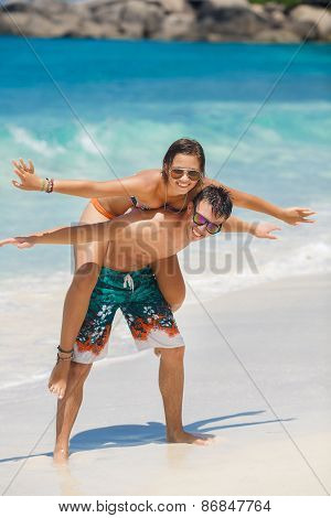 The couple are spending their honeymoon on a tropical beach.